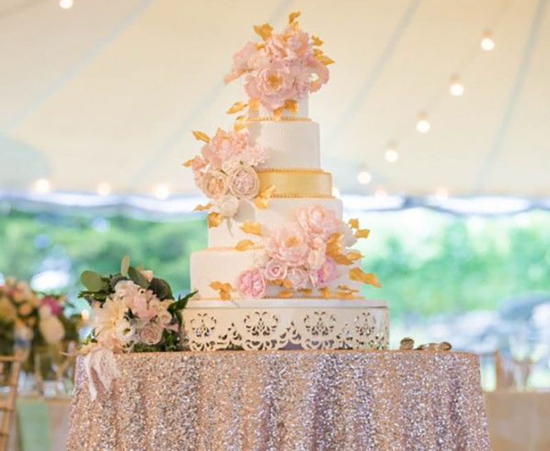 Pink sparkly and gold wedding cake at a blush and rose gold reception