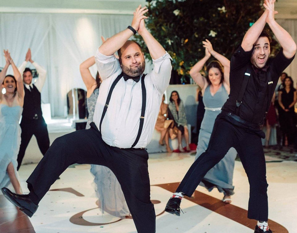 Bridesmaids and groomsmen perform choreographed dance at a wedding