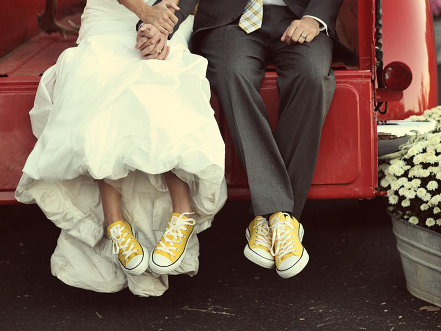 Benfield Photography of married couple sitting on a red truck