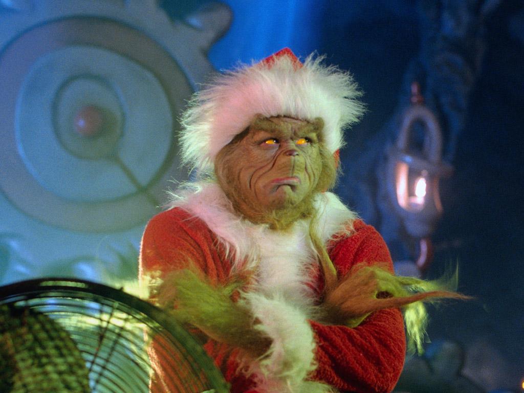 jim carrey as the grinch in santa costume