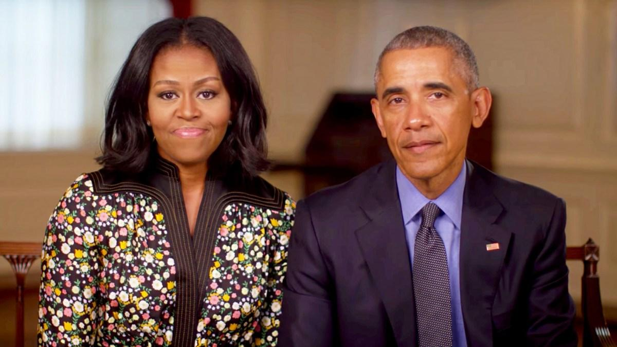 Barack and Michelle pose for a picture