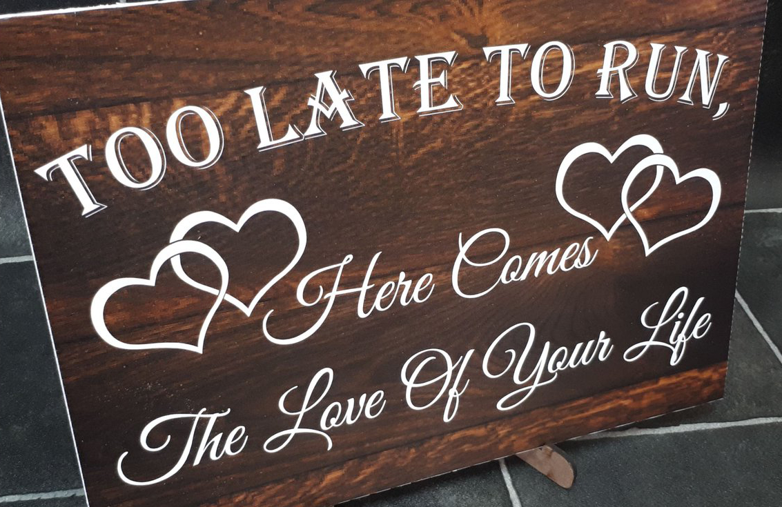 Wooden sign that says,