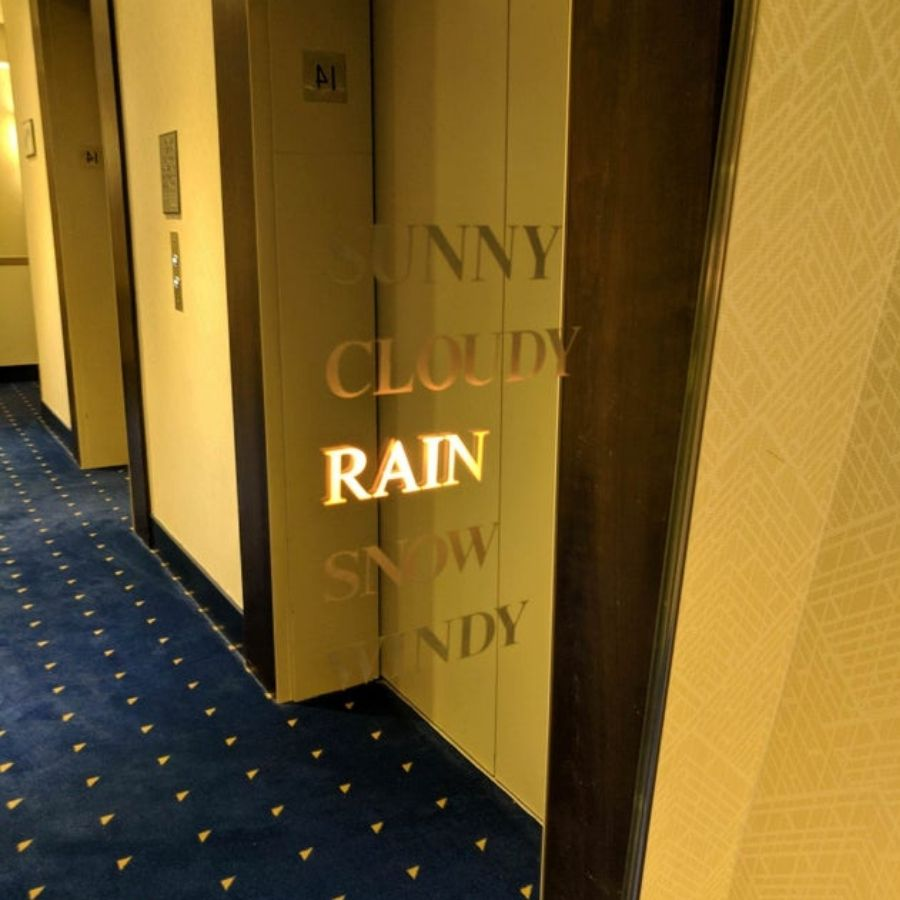 weather mirror in hotel before you get on the elevators
