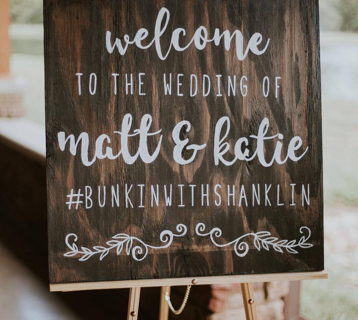 Sign of wedding listing the couple's wedding hashtag