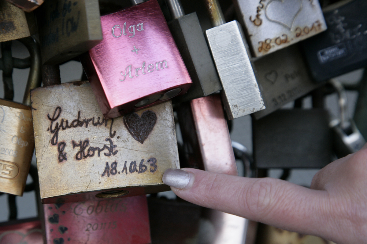 A lock from 1963 seen amidst locks on Hohenzollern Bridge, Germany