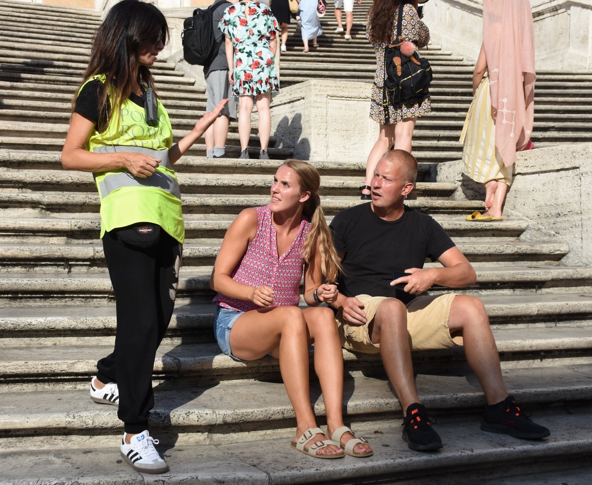 A local police officer patrols the Spanish steps off Trinita' dei Monti church in Rome telling people not to sit down