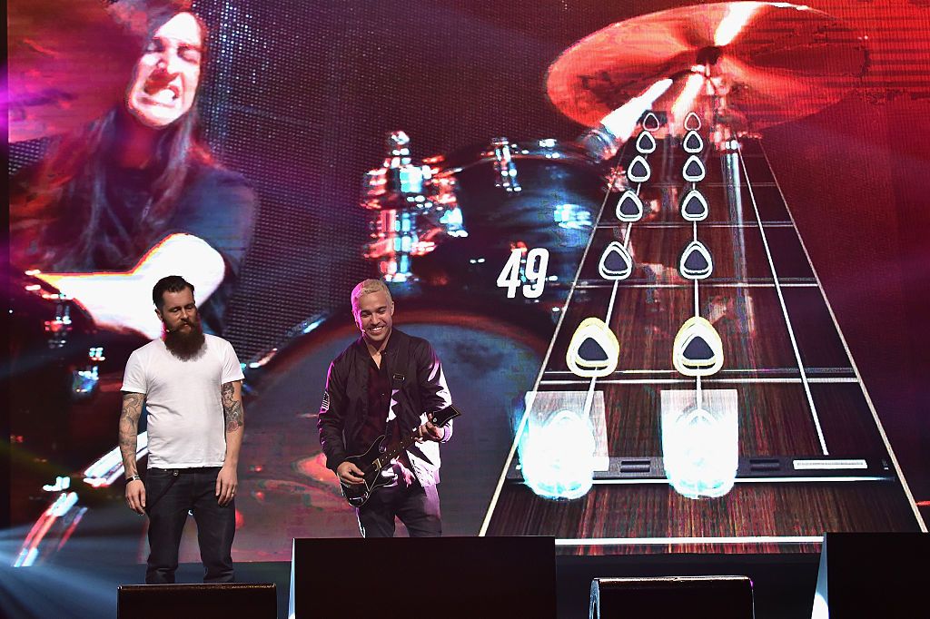 Rock musician Pete Wentz plays guitar hero onstage