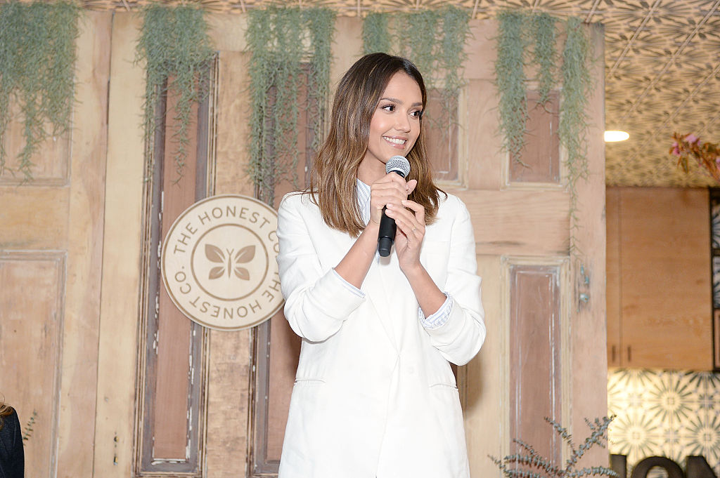 Jessica speaks onstage at an Honest Company event