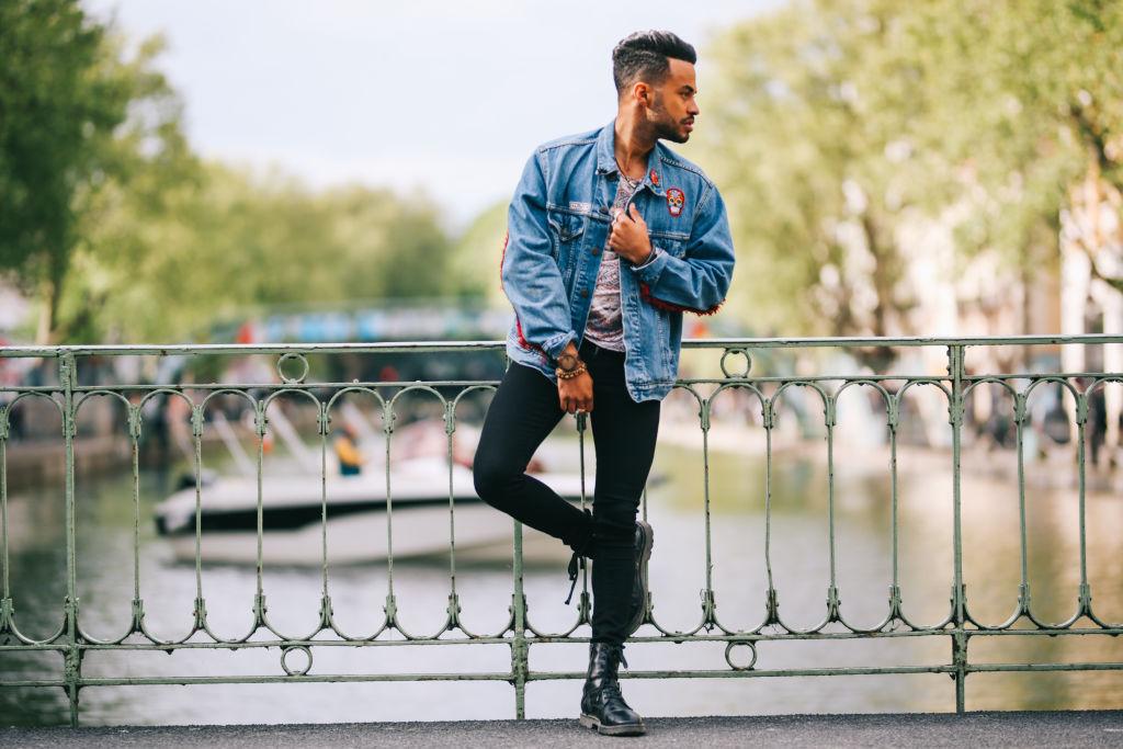 A male model wears skinny jeans