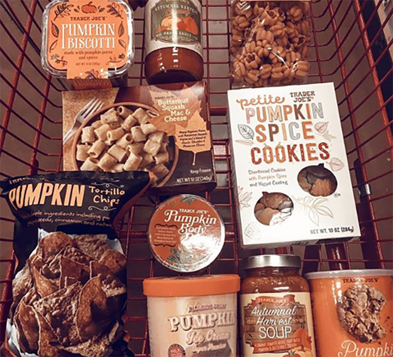 A grocery cart shows various pumpkin flavored items