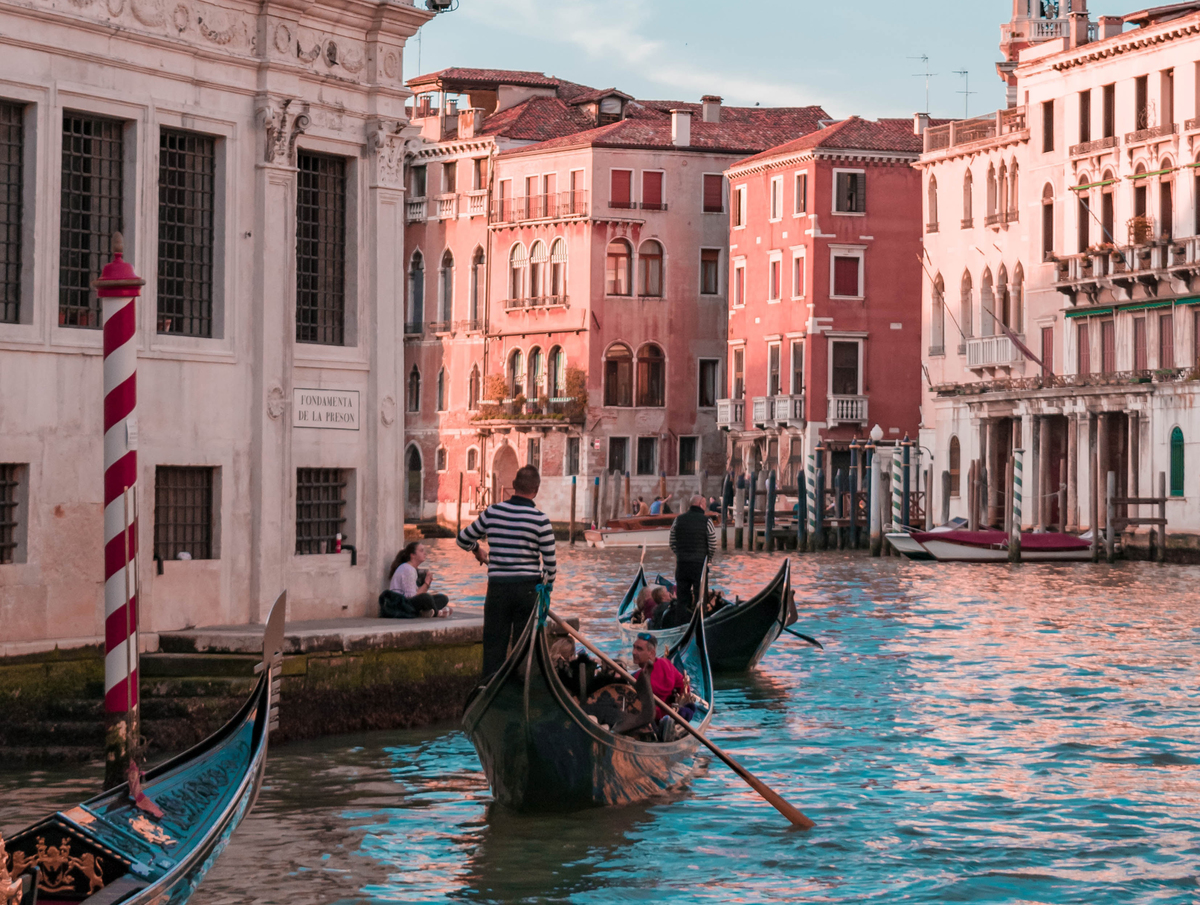 Tour guides row people around Venice's canals