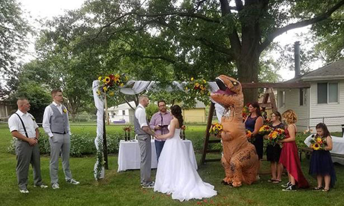 Maid of honor wears a dinosaur costume to her sister's wedding
