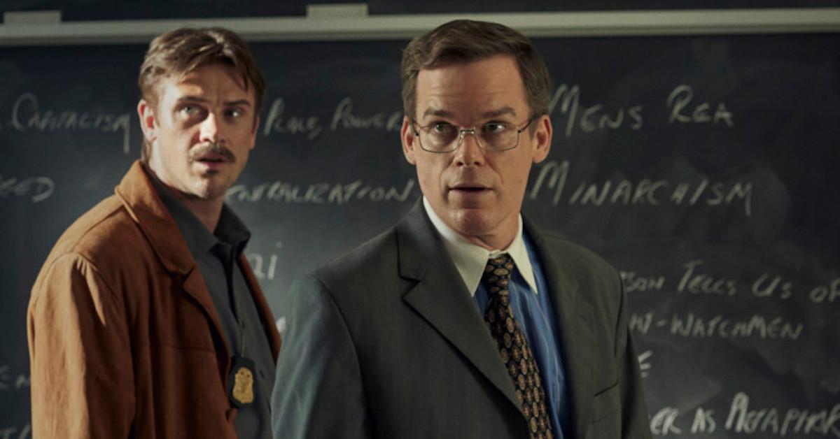 two men in front of a chalkboard