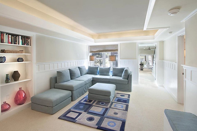 A large living space offers plenty of seating and light