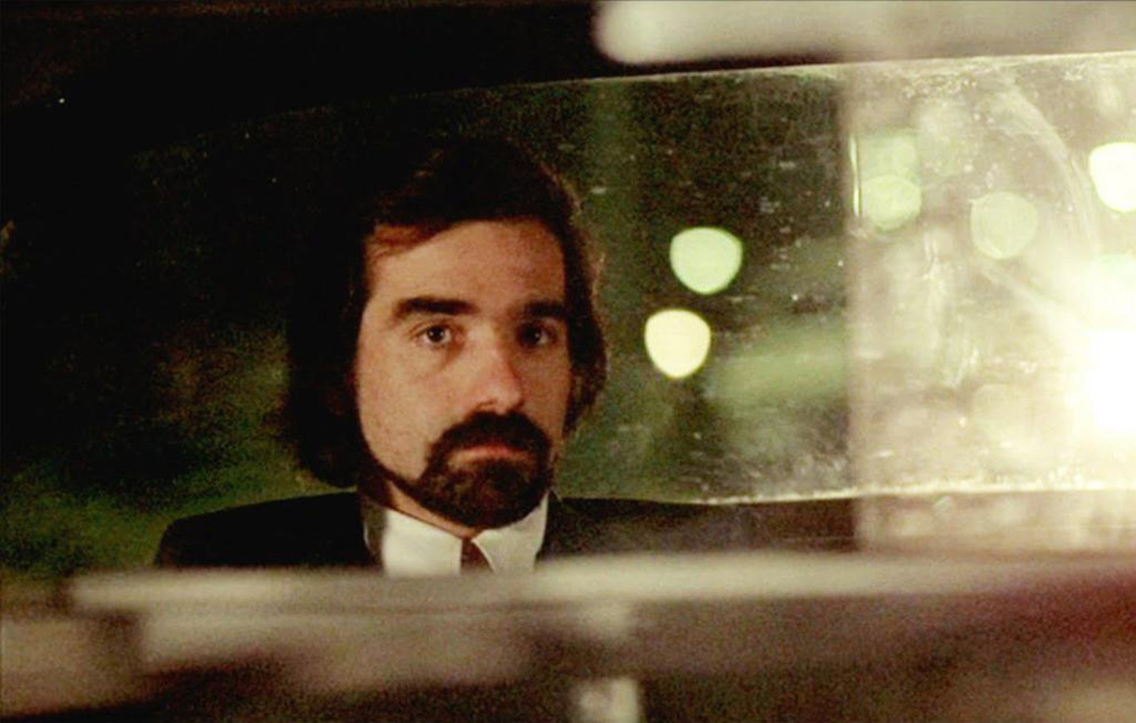 Scorsese sitting in the backseat
