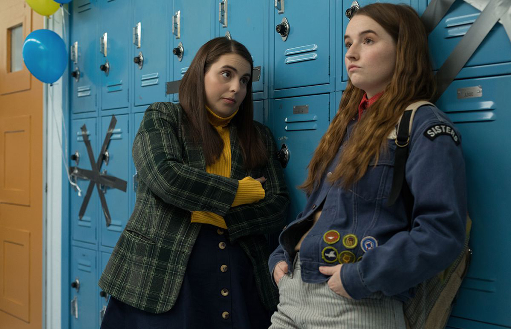 Girls leaning on lockers
