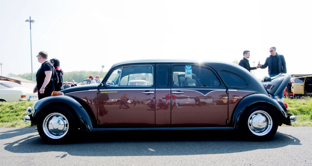 a volkswagen beetle turned into a limo