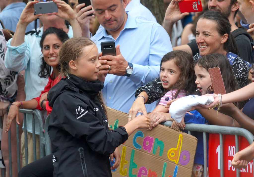 Greta is greeted by a crowd in the US