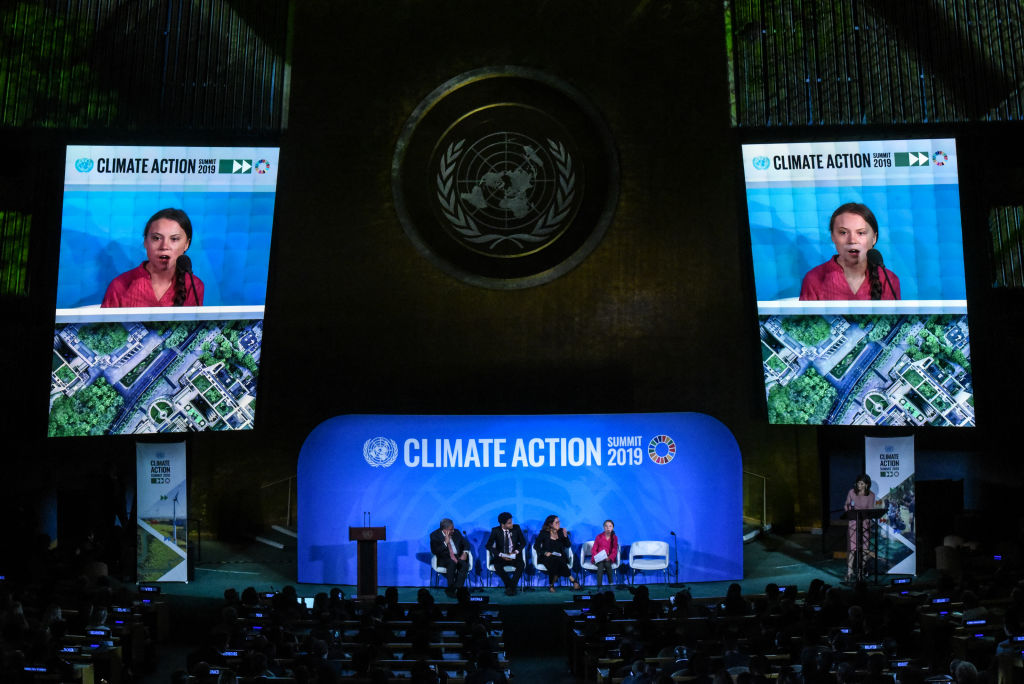 Greta appears on large screens at the Climate Action Summit