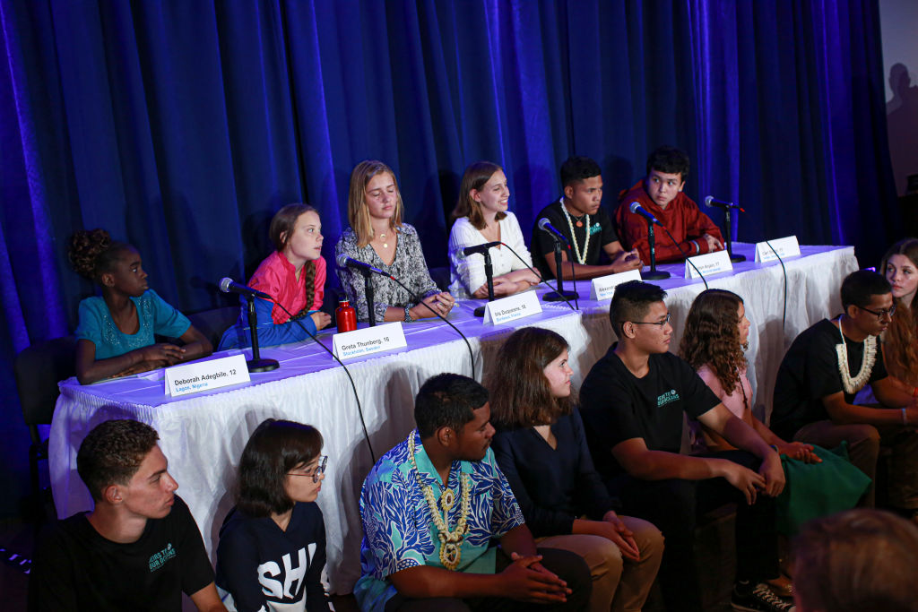 Greta and other teens sit at a UN press conference