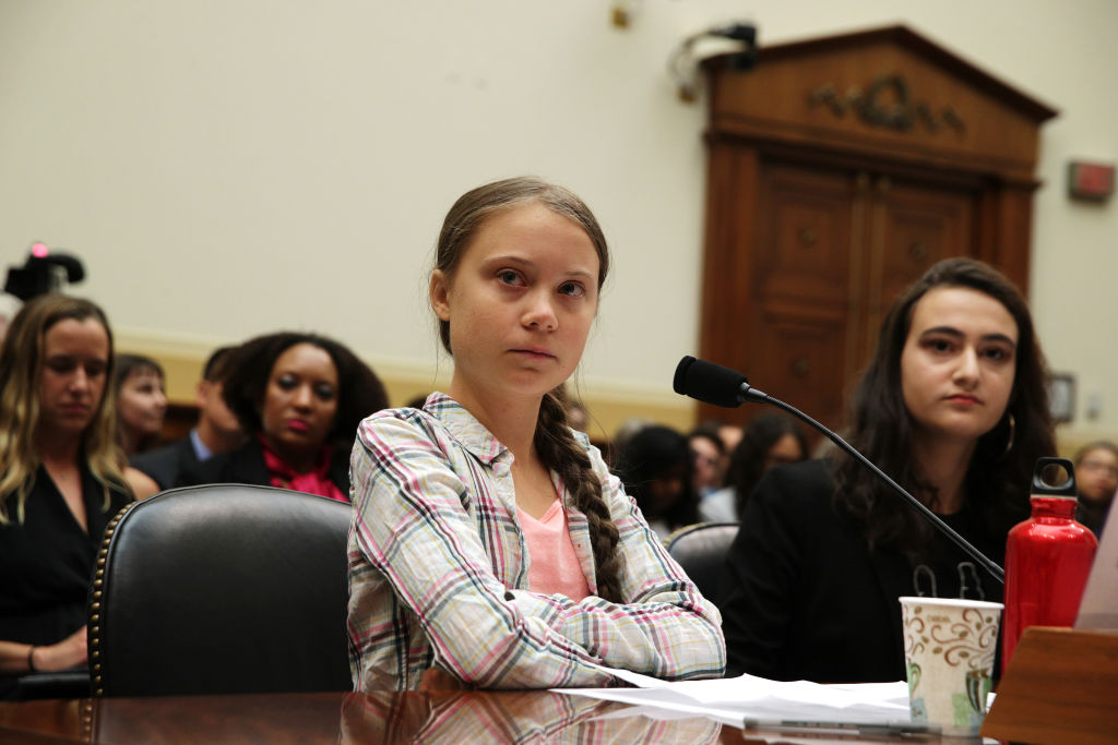 Greta crosses her arms while testifying at Capitol Hill