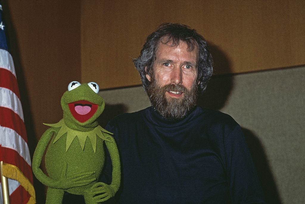 jim henson posing with kermit the frog