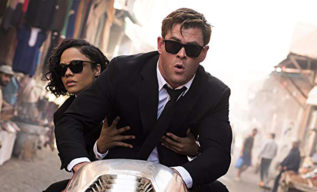 Chris Hemsworth and Tessa Thompson on a motorcycle
