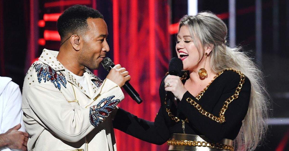 John Legend and Kelly Clarkson onstage during the 2018 Billboard Music Awards