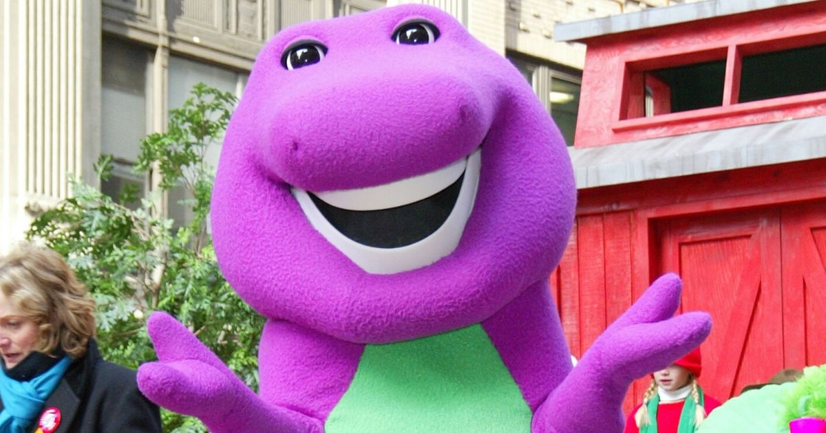 Barney the dinosaur rides on a float at the 76th Annual Macy's Thanksgiving Day Parade
