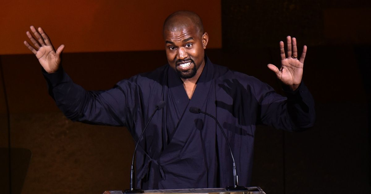 Kanye West on stage speaking at the 2015 CFDA Fashion Awards