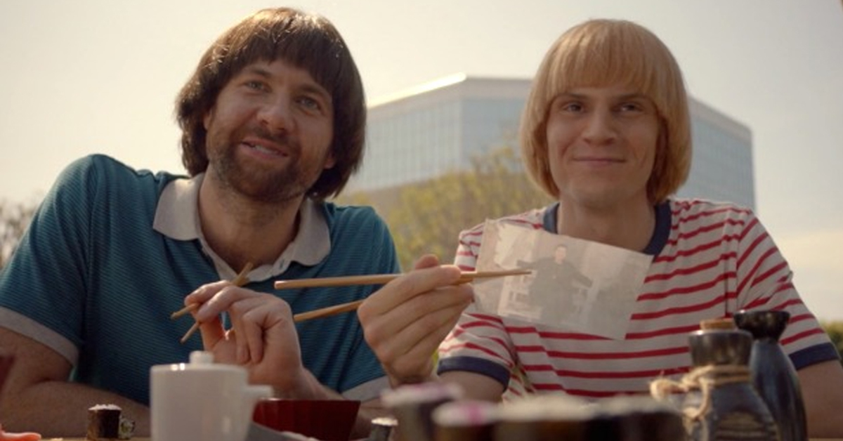 billy eichner and evan peters in bowl cuts holding chopsticks