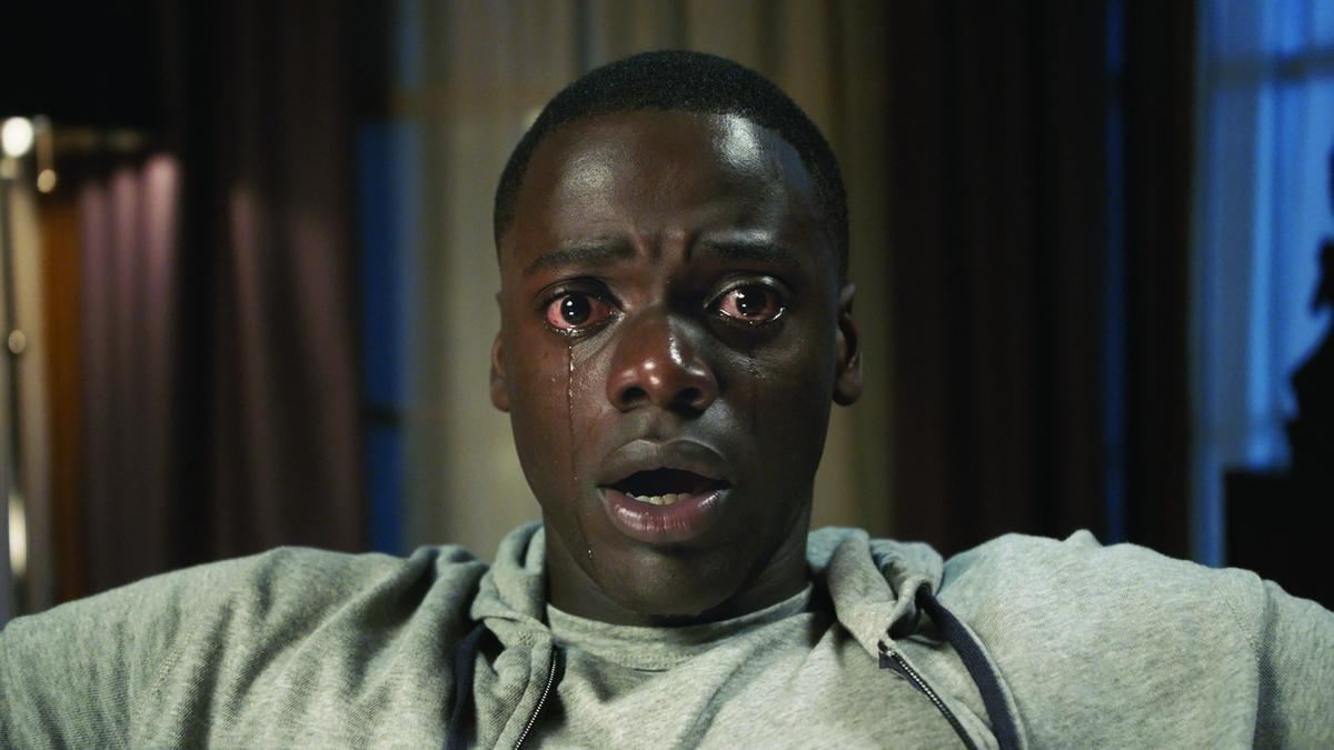 The lead in Get Out wears a shocked and tear-streaked facial expression