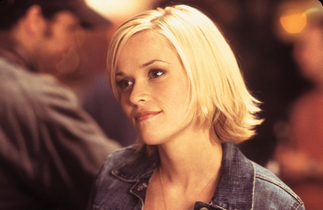 Reese Witherspoon offers a small smile