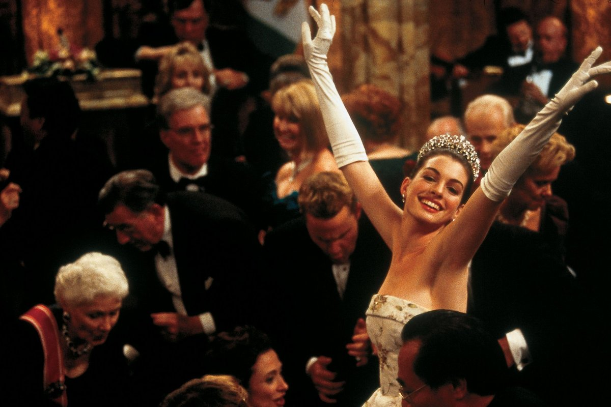 Princess Mia dances in a crowd of people