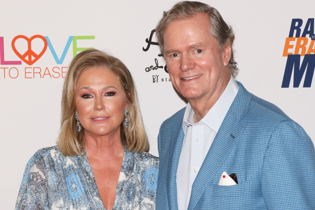 rick and kathy hilton dressed in blue posing for a photo on a red carpet