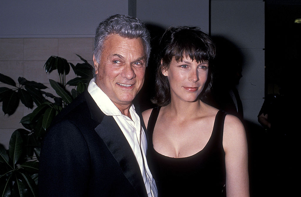 Jamie poses with her father at a dinner party circa 1989.