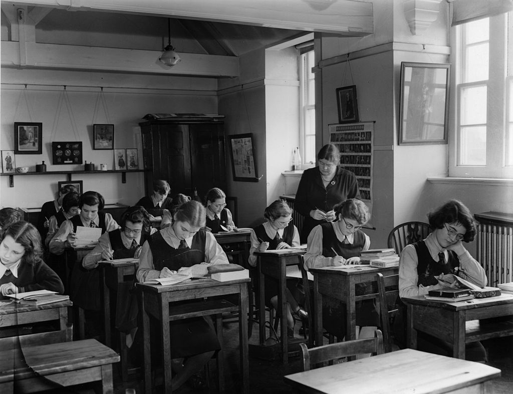 Girls do work in the classroom of a boarding school.