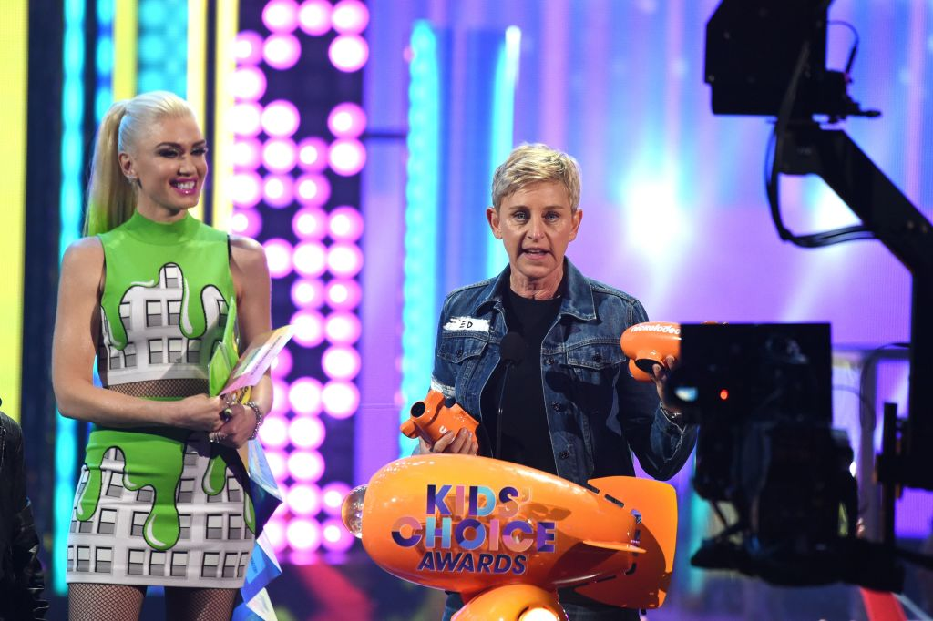 Ellen DeGeneres accepts the awards for Favorite Animated Movie for 'Finding Dory' from Gwen Stefani (L) on stage at the 30th Annual Nickelodeon Kids' Choice Awards,
