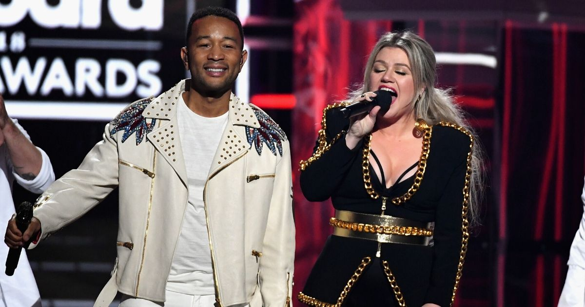 John Legend and Kelly Clarkson perform onstage