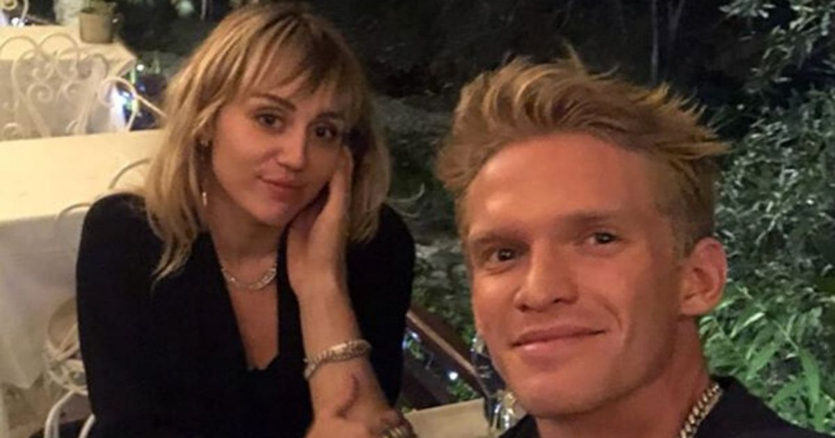 cody and miley at a dinner table