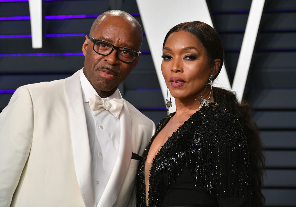 angela bassett and courtney b. vance in formal wear on a red carpet