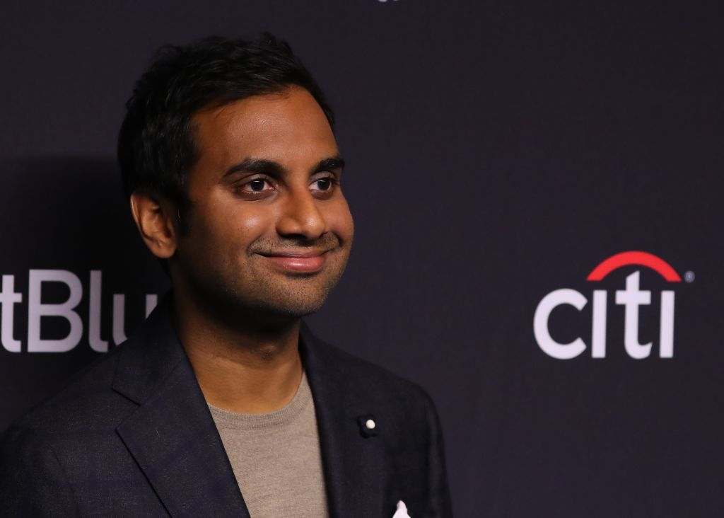 aziz ansari posing for a red carpet photo