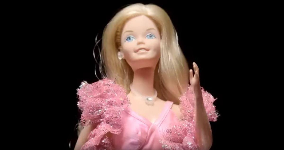 a barbie doll in a pink dress