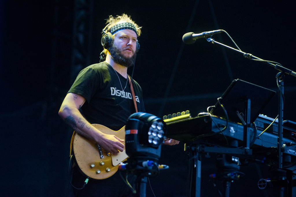 bon iver's justin vernon performing on stage at a festival