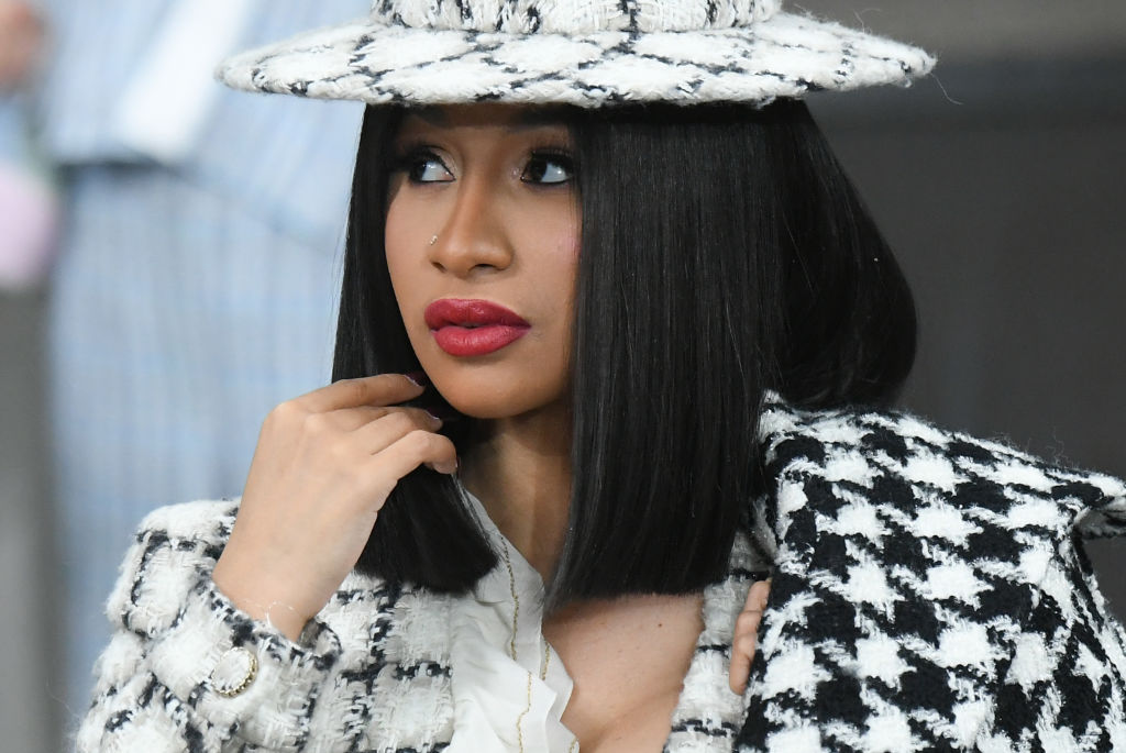 cardi b wearing a black and white ensemble at a fashion show