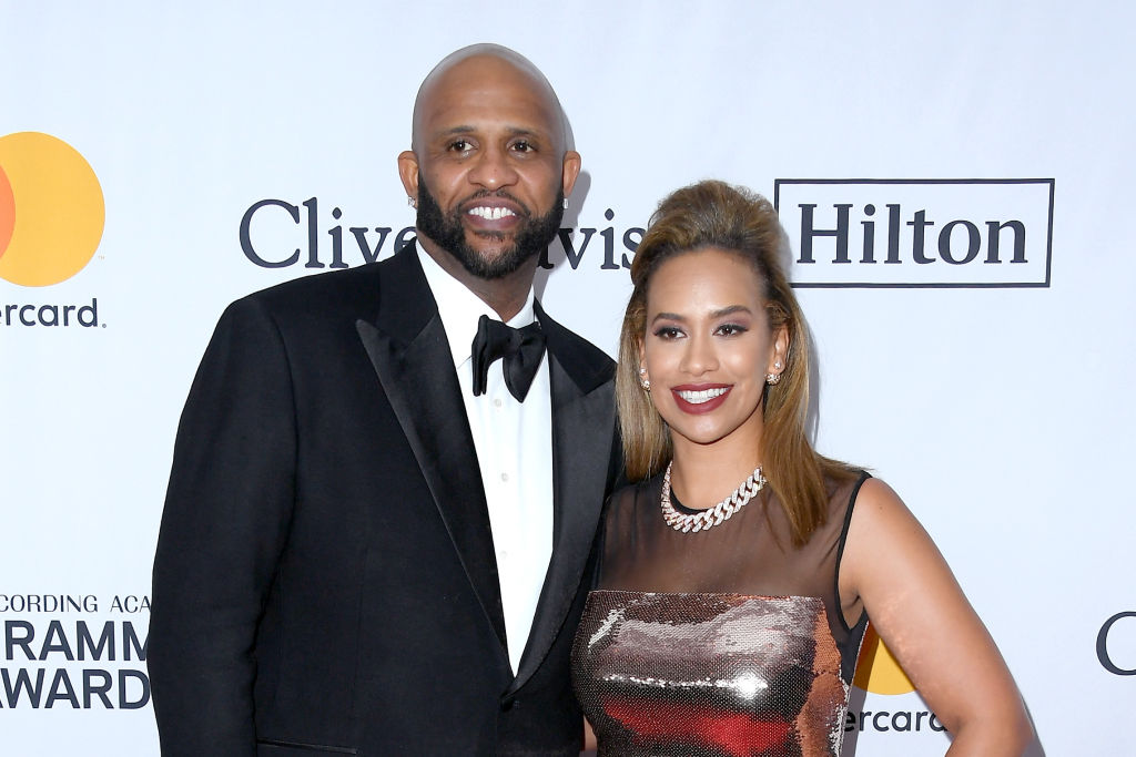 cc sabathia and wife amber at a gala red carpet event