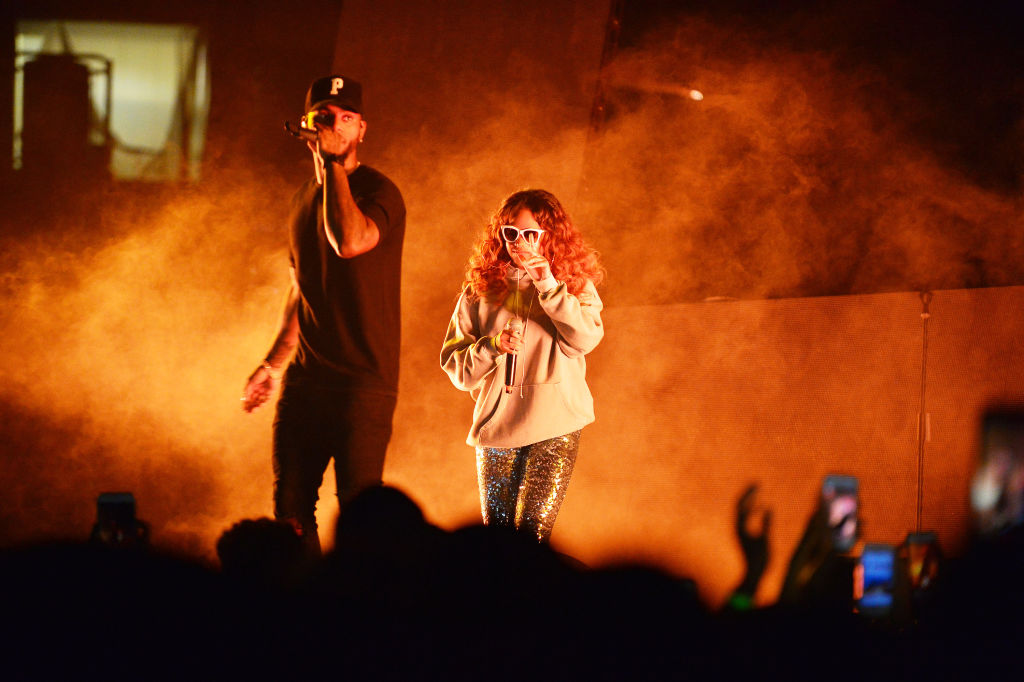 h.e.r. and bryson tiller performing on stage