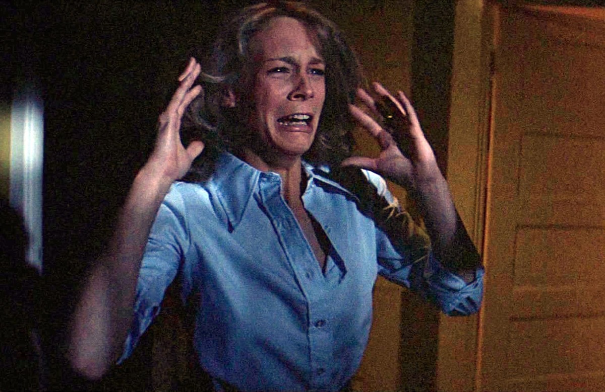 Jamie Lee Curtis wears a frantic expression while filming the movie Halloween.