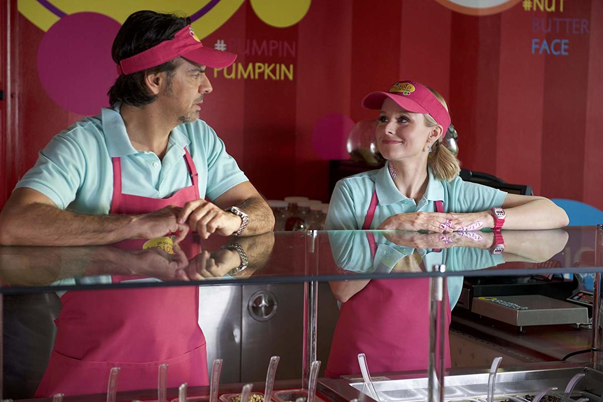 eugenio derbez and kristen bell working at a frozen yogurt shop