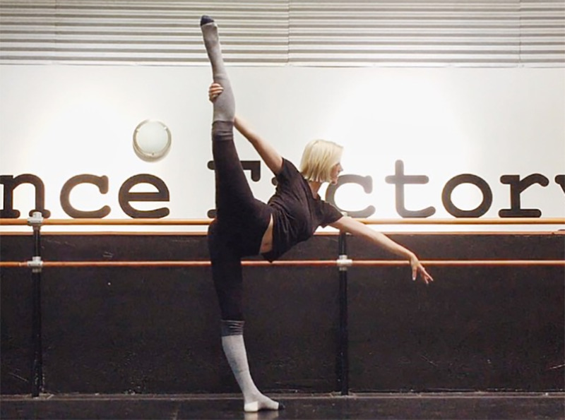 Jamie Lee's daughter, Annie Guest, does standing splits at a dance studio.